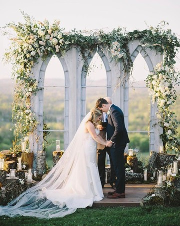 Shawn Johnson East and Andrew East at the Alter