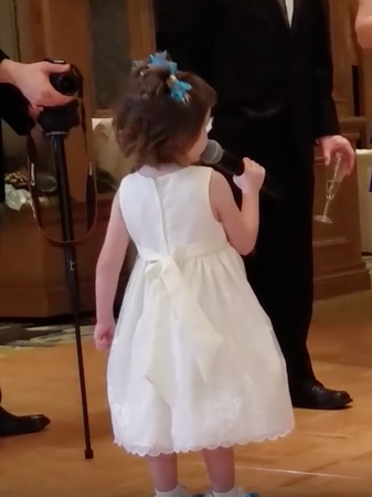 little girl giving wedding toast