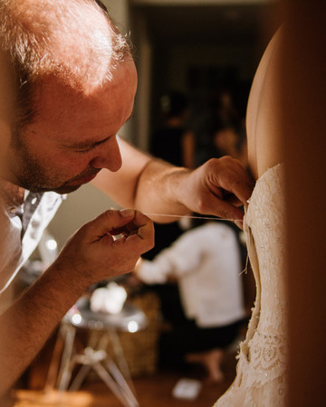 Syrian Refugee Fixing Wedding Dress Zipper
