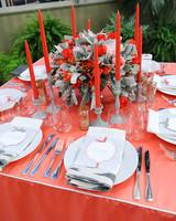 Red Candles Around Floral Winter Centerpiece