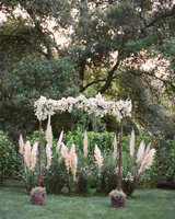 Thin Wooden Wedding Arch with Blush Flowers
