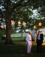 wooden lanterns hanging from trees