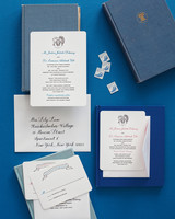 blue, red, and white wedding invitation