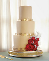 Gold Wedding Cake with Red Flowers