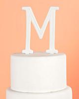 white porcelain monogram cake topper