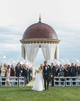 rainy wedding bride and groom outside recessional