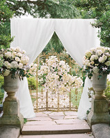 White Canopy and Gold Gate Wedding Arch
