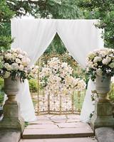 elizabeth-cody-real-wedding-ceremony-arch.jpg