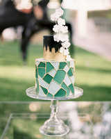 green, black, and gold wedding cake