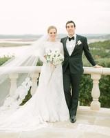 Bride in Lace Long-Sleeve Wedding Gown and Long Veil