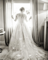 Bride Wearing Short-Sleeve Wedding Gown and Long Floral Veil