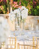 Elegant, modern white orchid wedding centerpiece