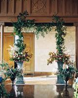Flower Arrangement and Greenery Garland Wedding Arch