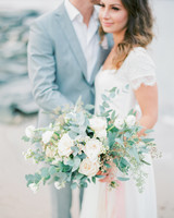 Groom and Bride Holding a Wedding Bouquet