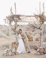 Wedding Arch with Crochet, Foliage, and Orange Flowers