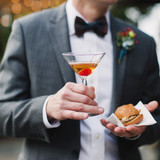 Wedding Attendee Holding Cocktail and Slider