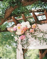 Wooden Wedding Arch with White Lace and Pink Flowers