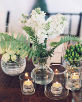Tea Lights in Glass Vessels on Wooden Table