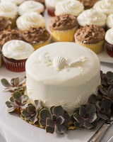 White Cake with Seashell Topper