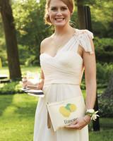 guest holding lemon clutch