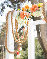 Pink, Orange, and White Wedding Arch with Ship Rope