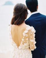 Bride Wearing V-Back Long-Sleeve Floral Appliqué Wedding Dress