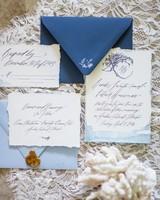 calligraphed blue wedding invitation