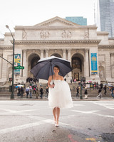 bride-with-umbrella-wedding-photo-ira-lippke-studios-0716.jpg