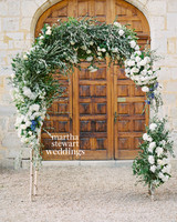 Lush Green and White Wedding Arch with Blue Accents