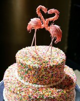 wedding cake with sprinkles and flamingo topper
