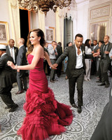Chrissy Teigen in Red Wedding Gown with Ruffled Skirt