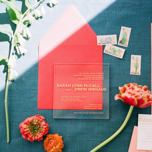 Clear modern wedding invitations with gold lettering