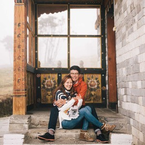 couple hugging sitting on front steps