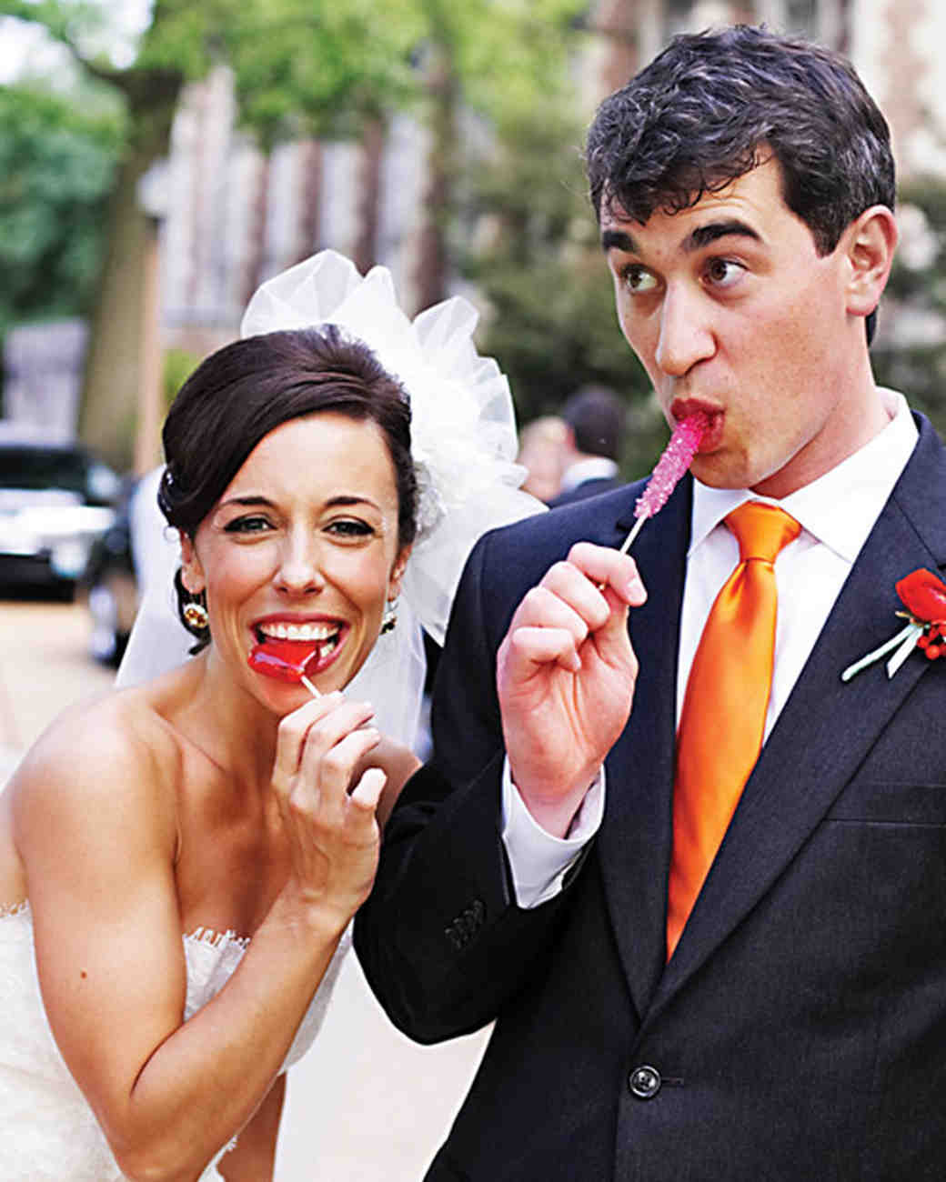Bride and Groom Holding Lollipops