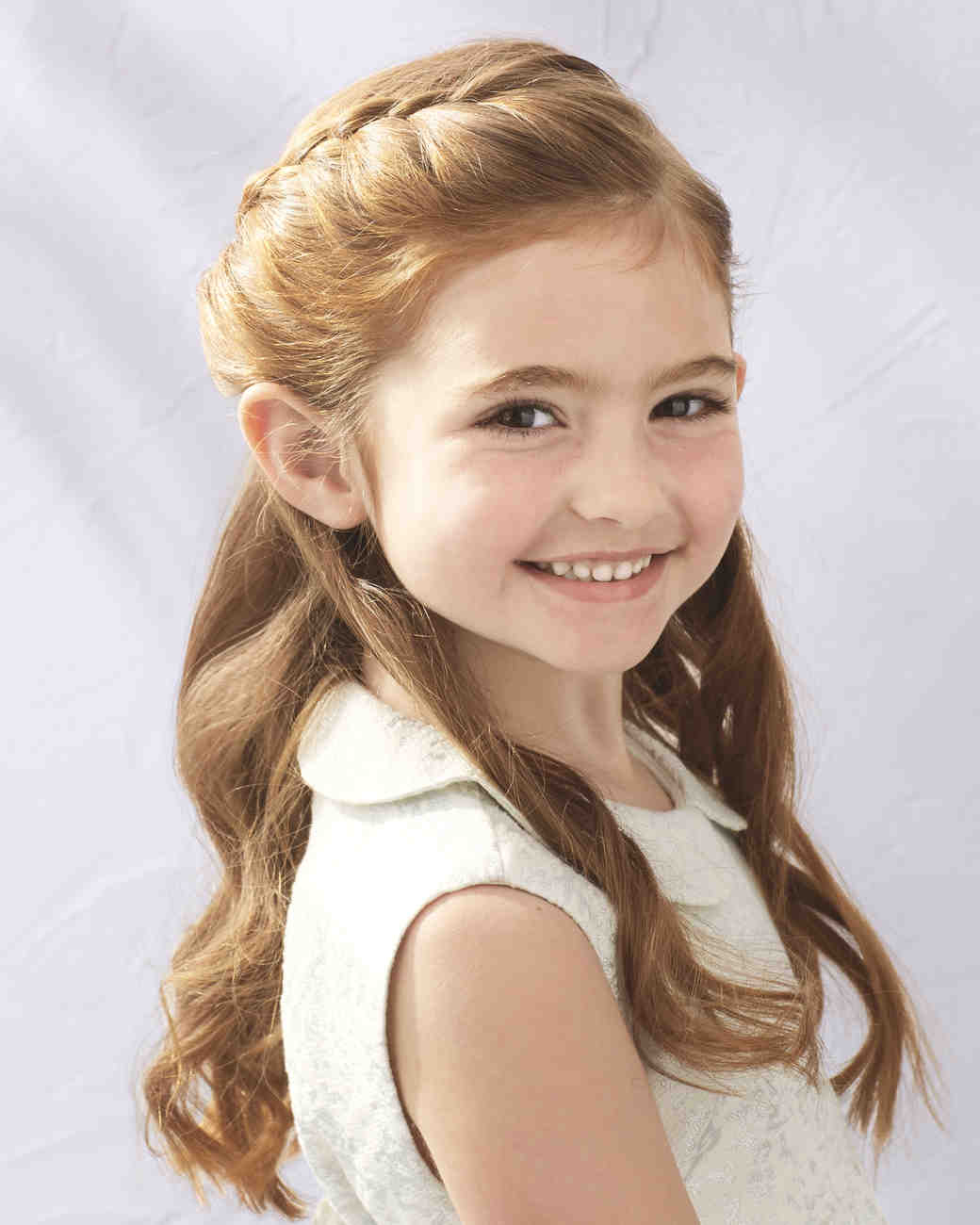 flower girl hairstyles that are cute and comfy martha stewart weddings. Black Bedroom Furniture Sets. Home Design Ideas