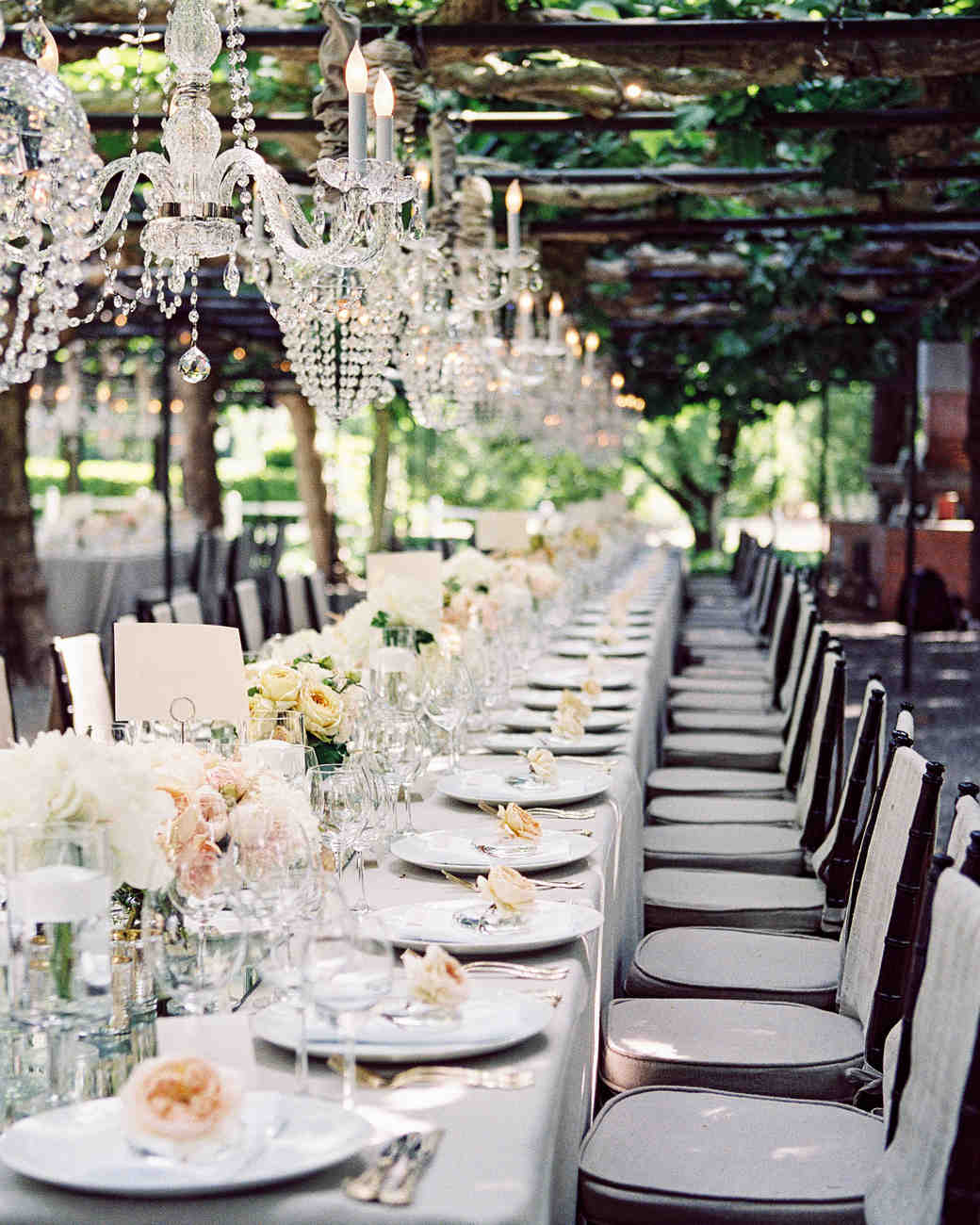 chandeliers over outdoor reception table