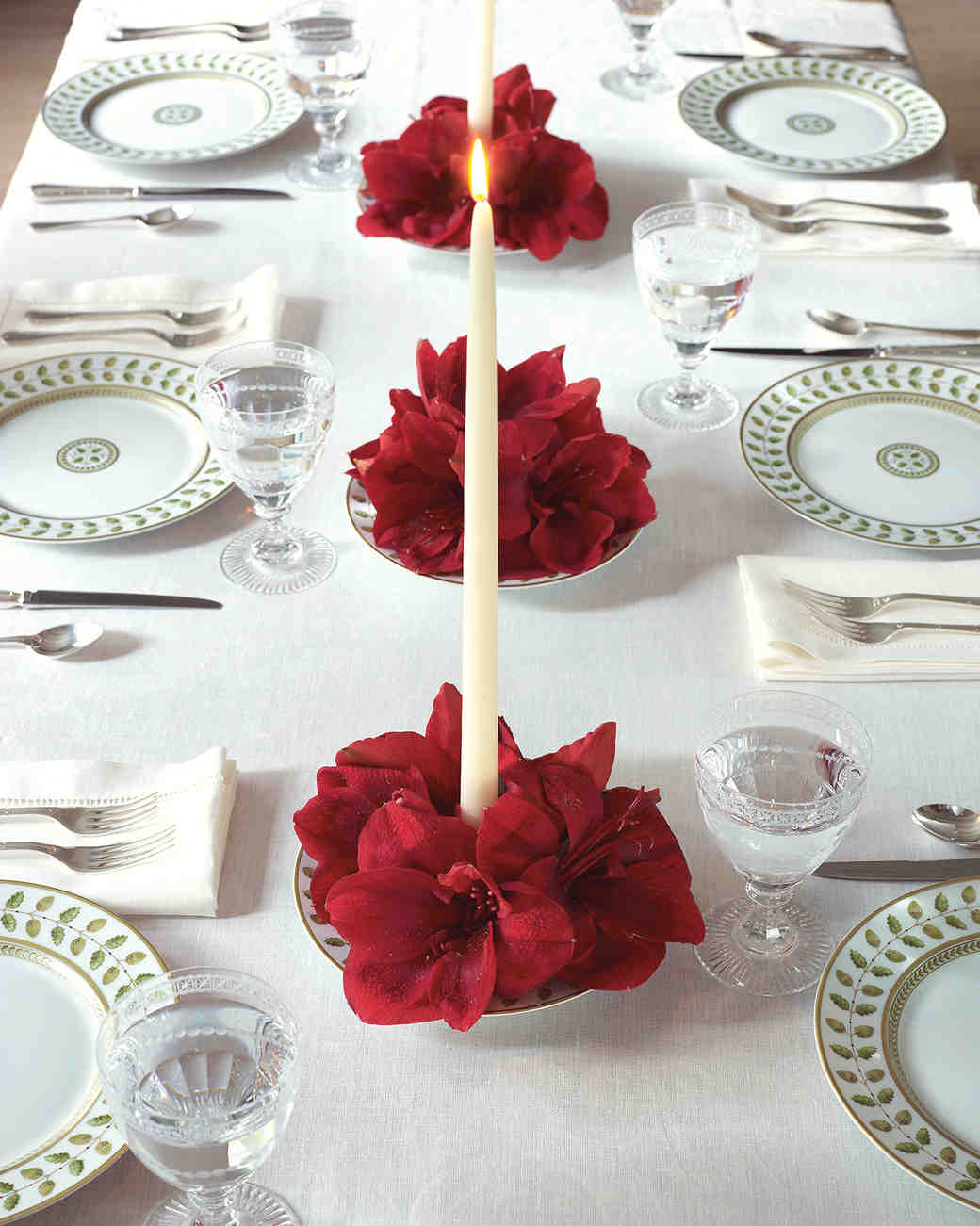 Tall White Candle in Red Floral Centerpiece