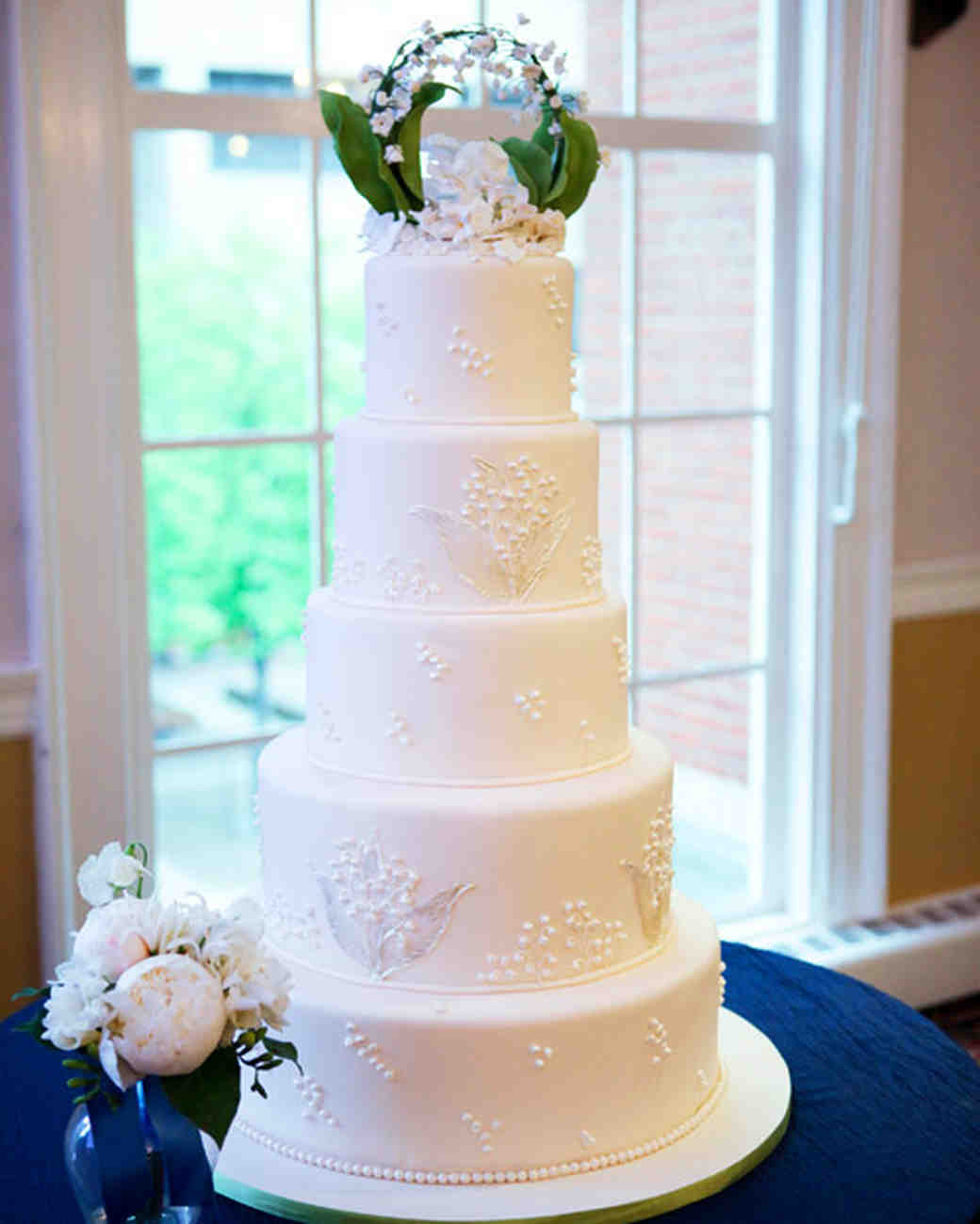 Five-Tiered White Wedding Cake with Lily of the Valley Sugar Sculpture