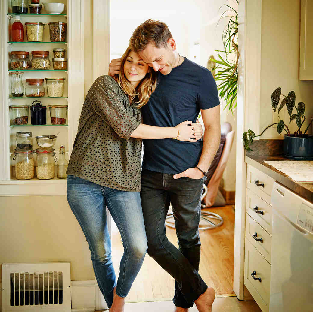 Couple Hugging in Home