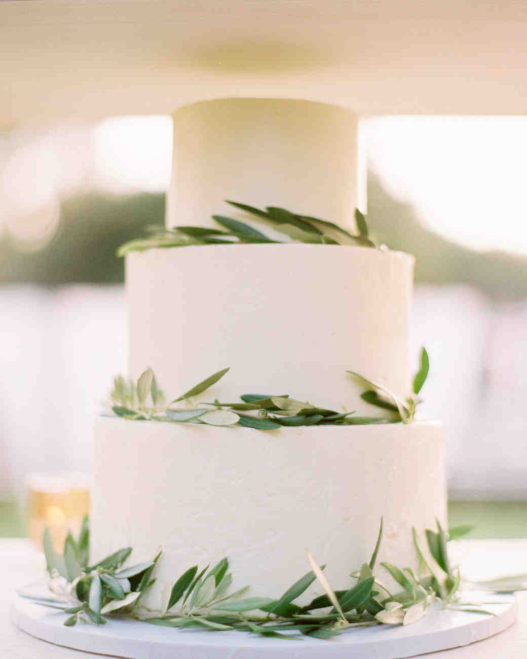Three-Tiered White Wedding Cake with Wraparound Olive Branches
