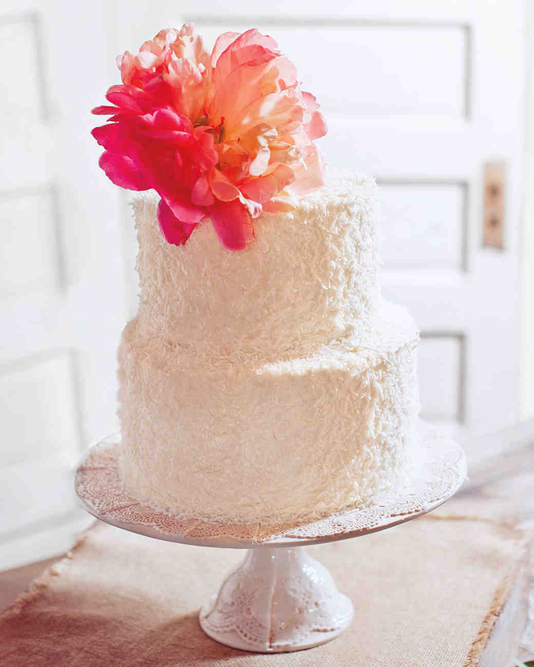 Two-Tiered White Coconut-Covered Wedding Cake with Coral Peony