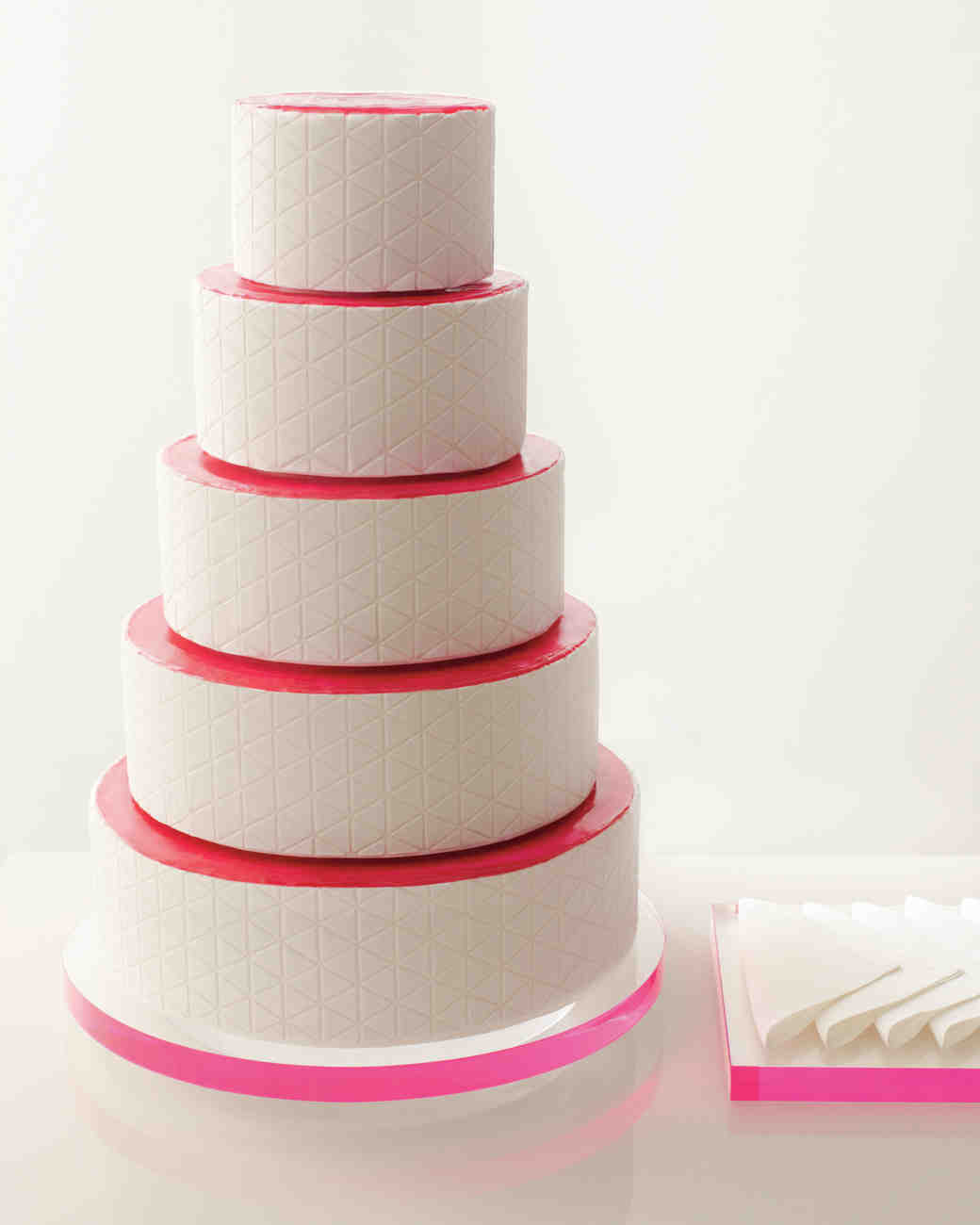 Five-Tiered White Wedding Cake with Hot Pink Accents