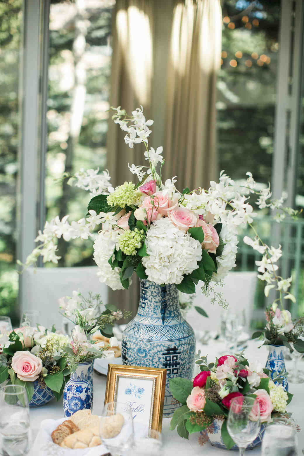 Vintage Bridal Shower Decor with Antique Vases and Flowers