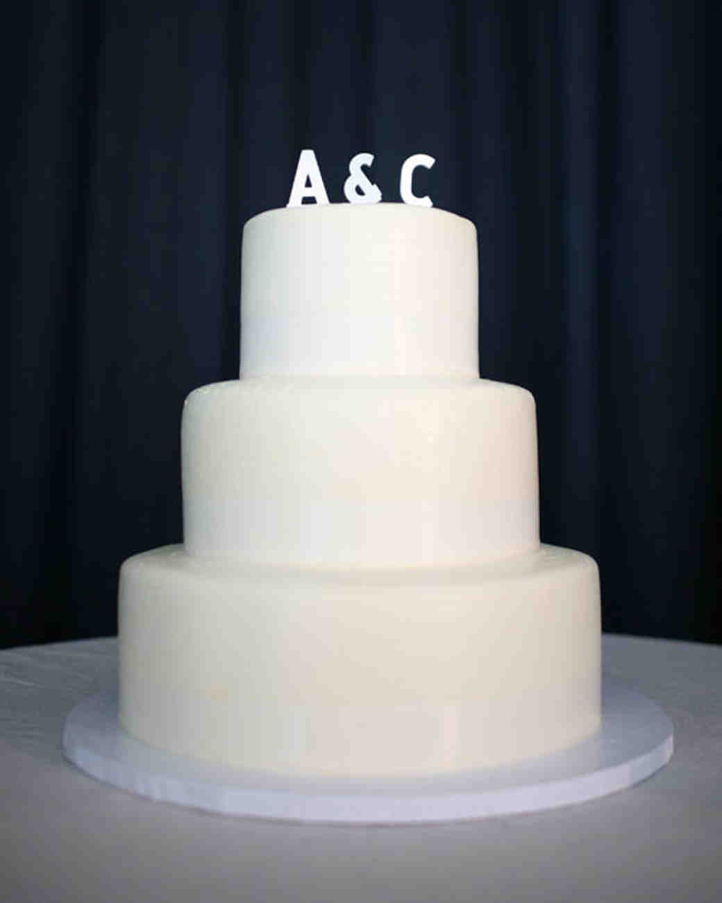Simple White Wedding Cake with White Initial Topper