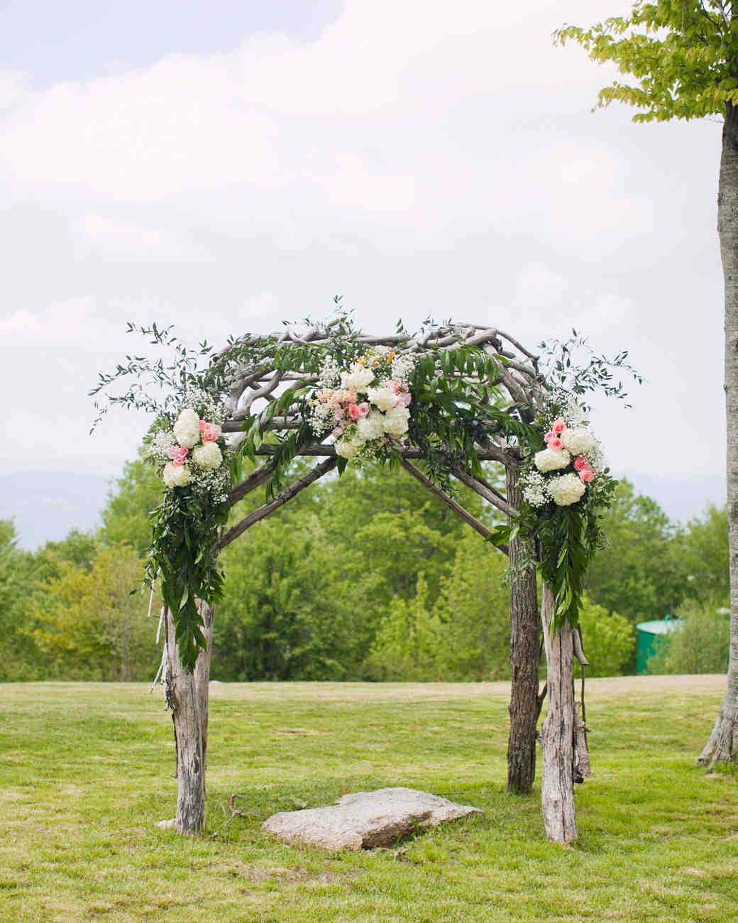 Wooden Wedding Arbor with White and Pink Flower Clusters