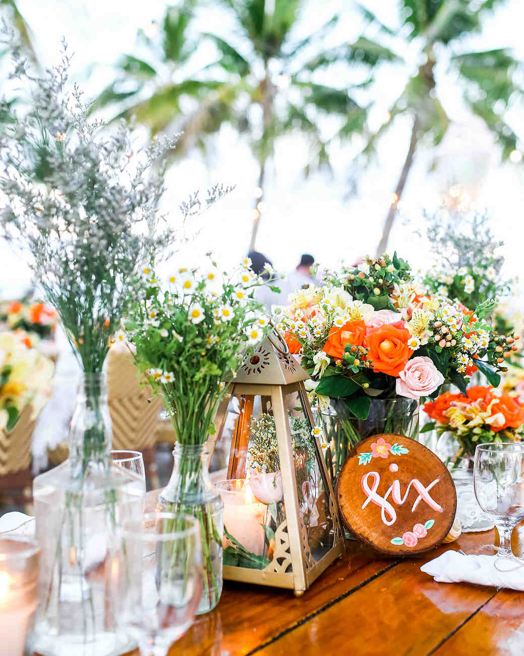Cluster Centerpieces with Roses and Lanterns