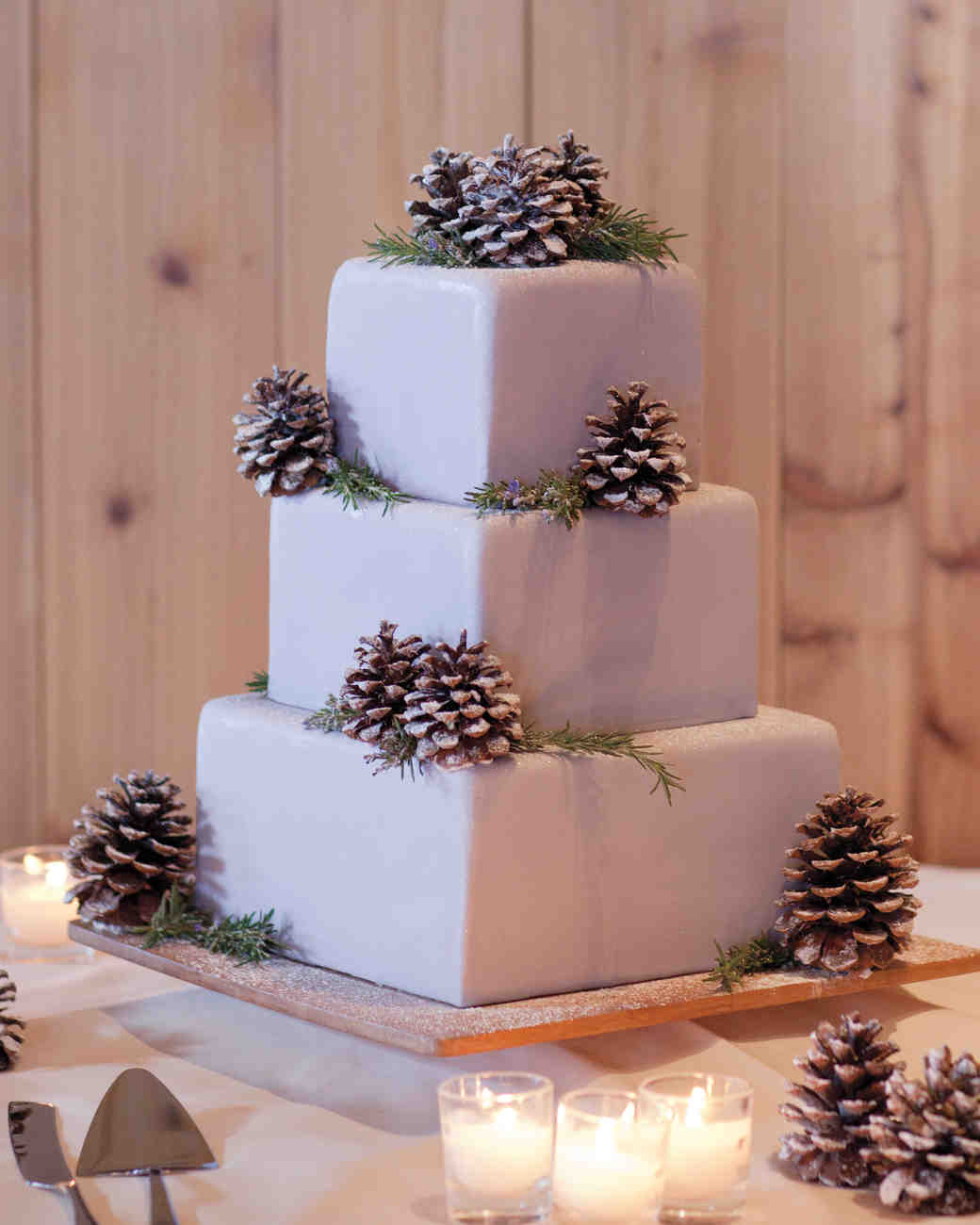 purple wedding cakes with pinecones