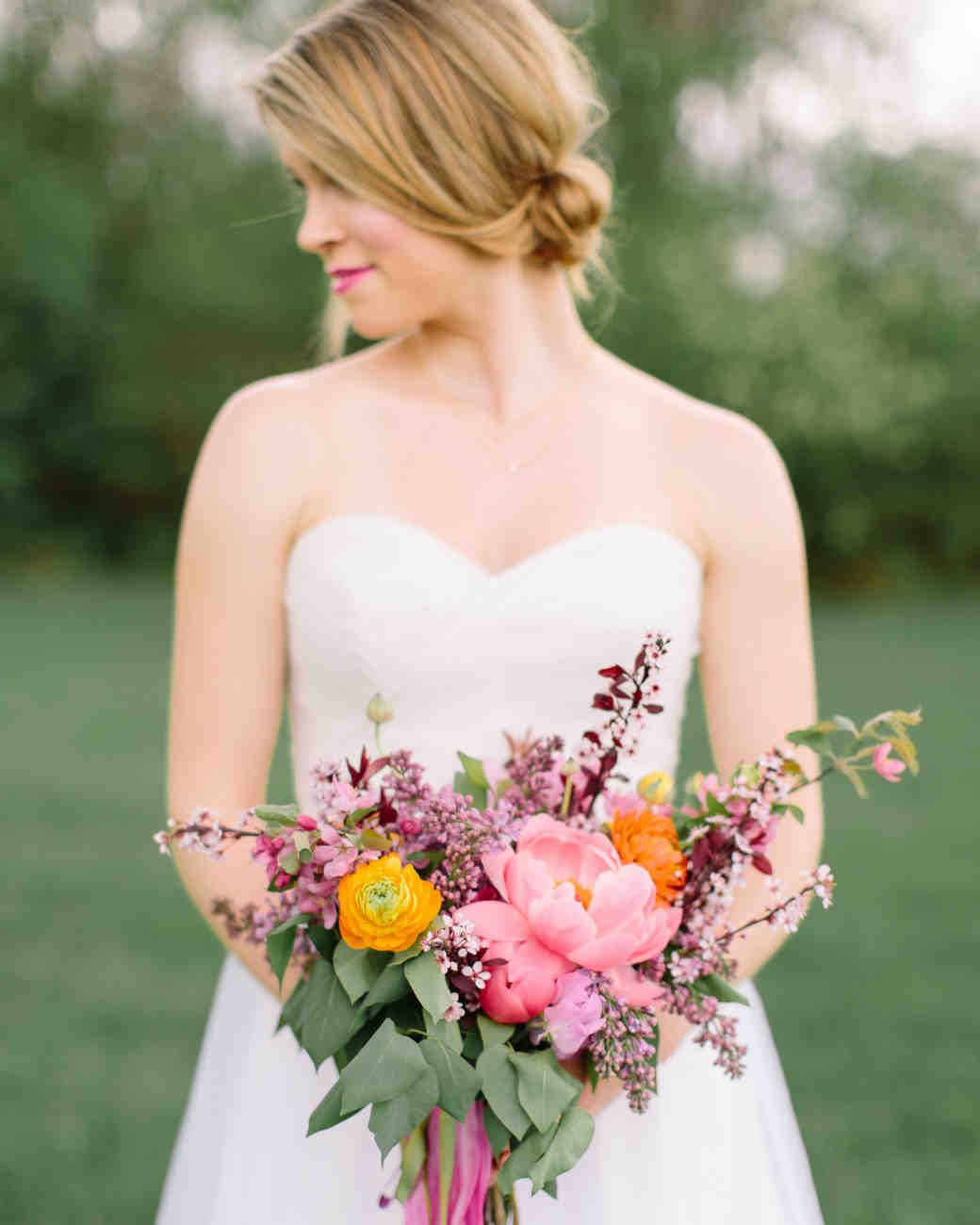 A Bride Holding a Pink and Orange Lilac Bouquet