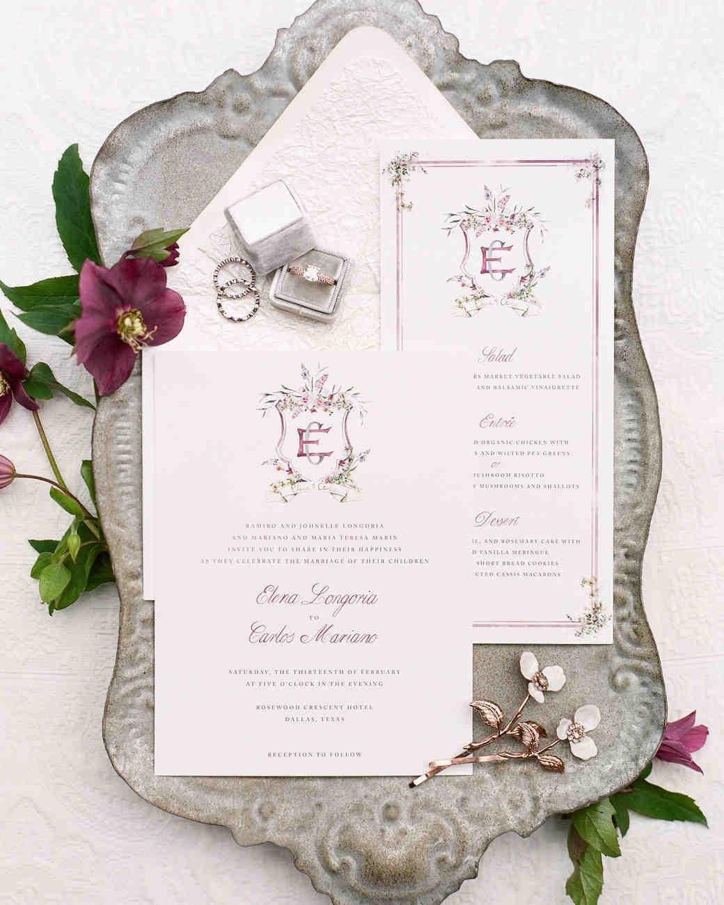 Elegant white wedding invitation suite with floral monogram