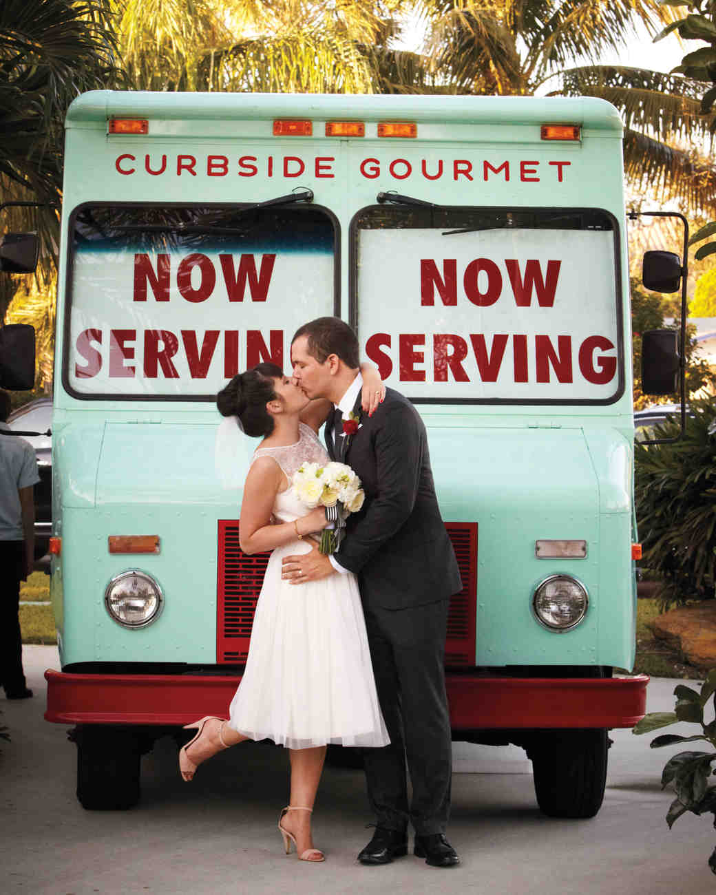 Bride and Groom Kissing in Front of Food Truck
